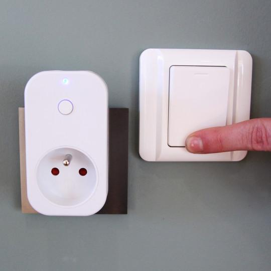 Prise commandable à distance avec interrupteur